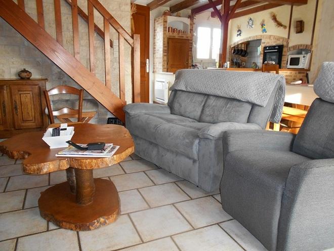 salon avec fauteuil et canapé position relax